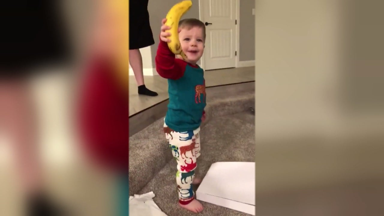 2 Year Old Boy In Awe Of Banana He Got For Christmas