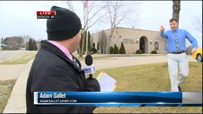 Watch A Bank Robber Interrupt This News Reporter During