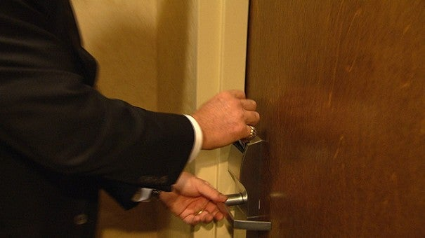 person locking door. hotel room locks being hacked sounds alarm for big chains   inside edition person locking door