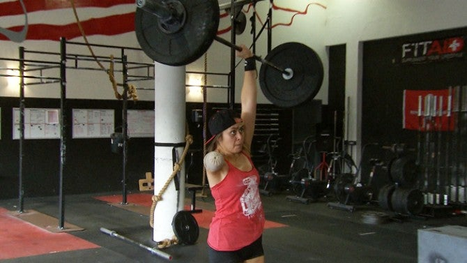 Female One Armed Weightlifter Deadlifts Over 200 Pounds