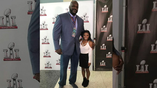 The Odd Couple Shaquille O Neal Towers Over Simone Biles