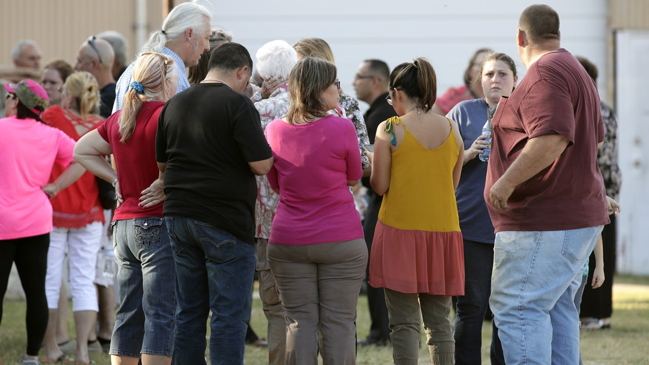 People gather near First Baptist Church following the shooting on Nov. 5 in Texas.