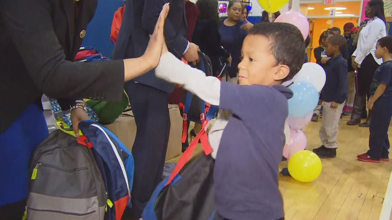 Elementary School Children Given Backpacks Filled With ...