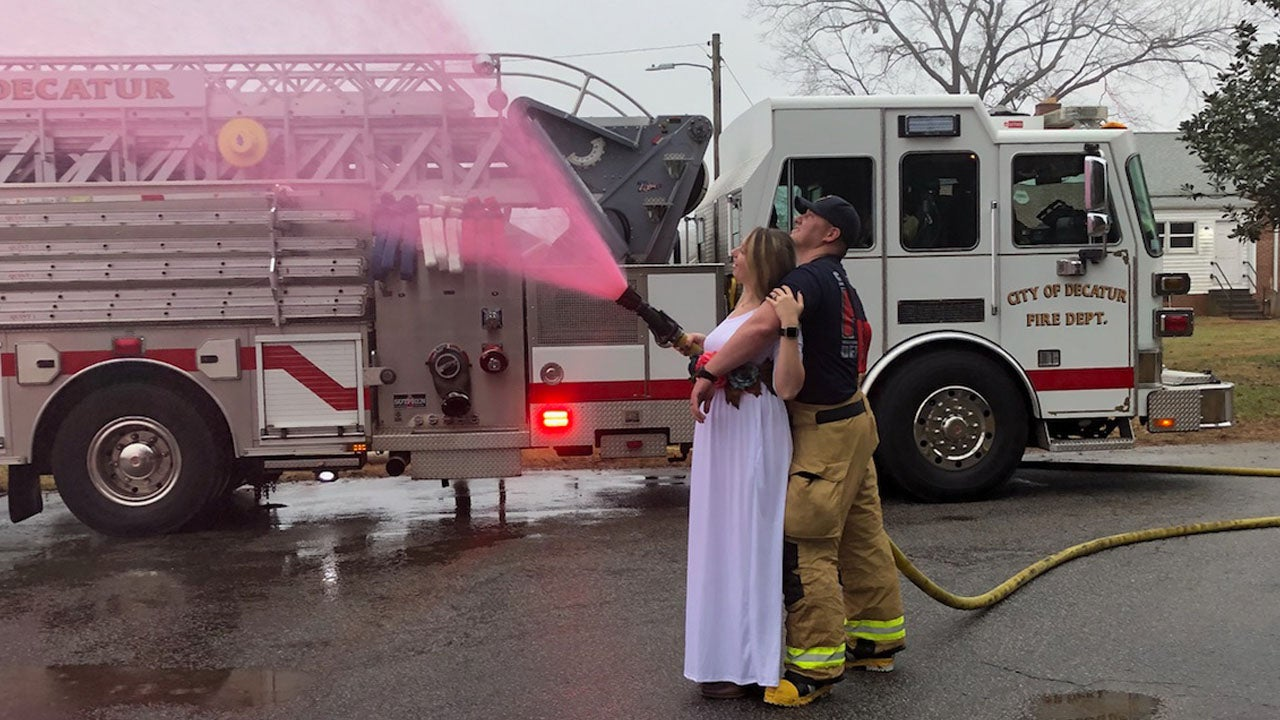 Firefighter And Wife Use Fire Hose For Baby S Gender