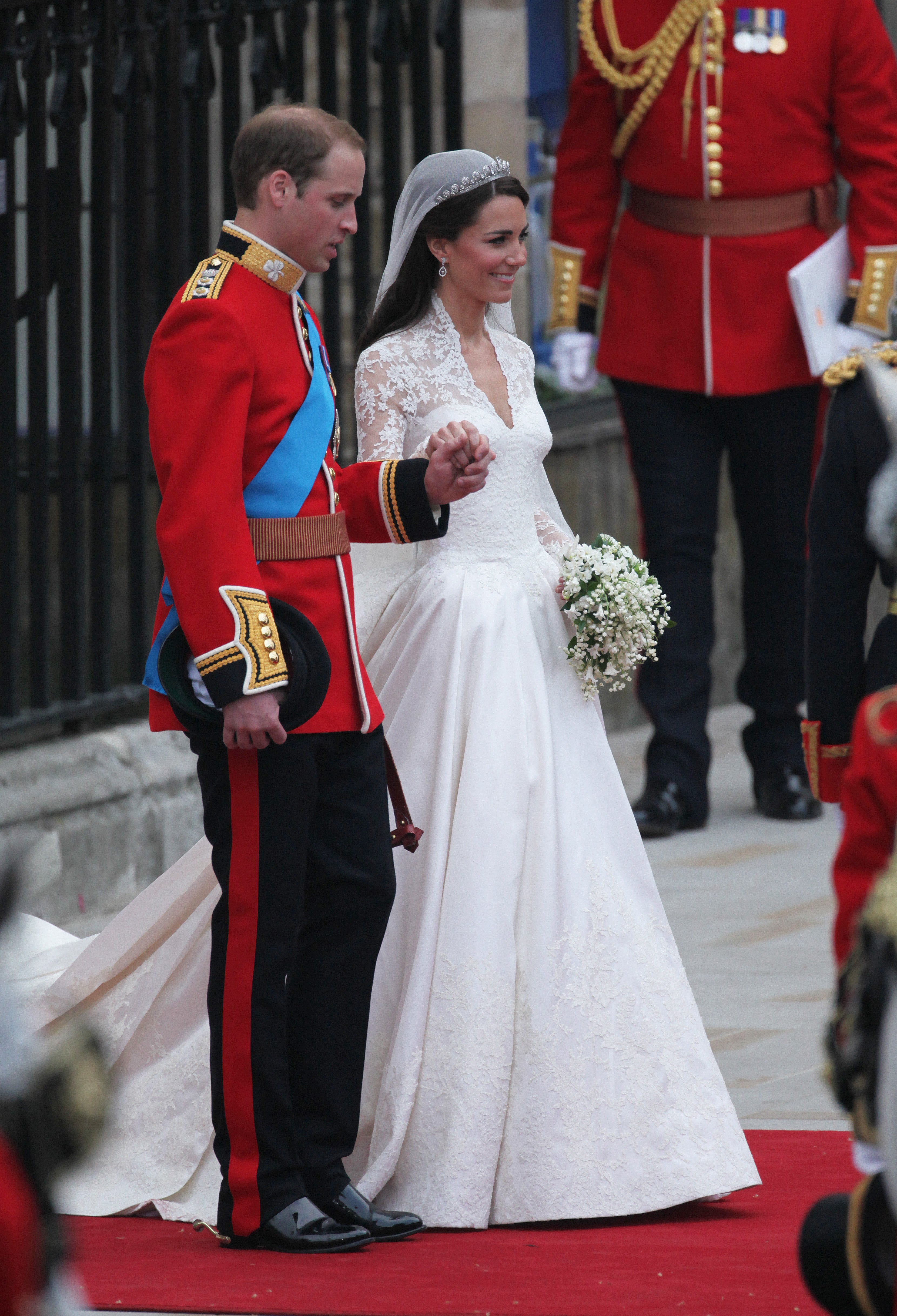 Kate Middleton's lace dress was designed by Sarah Burton for Alexander McQueen.