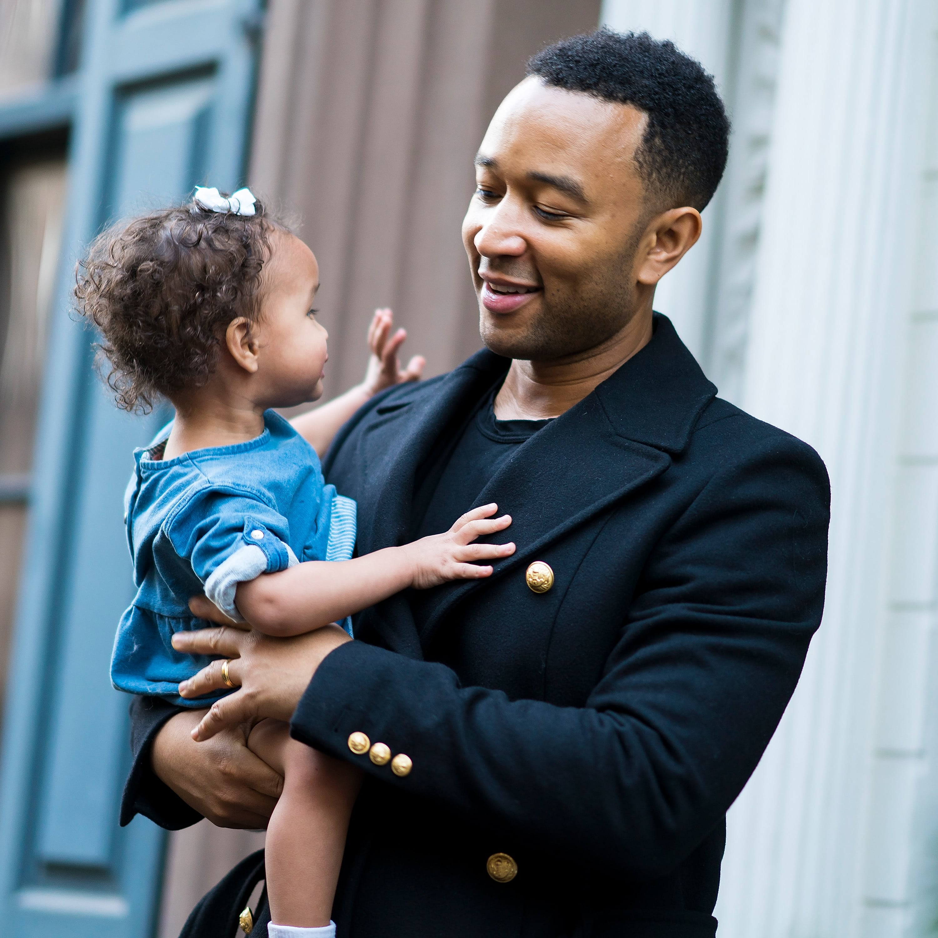 Musician John Legend shares a tender look with his daughter, Luna.