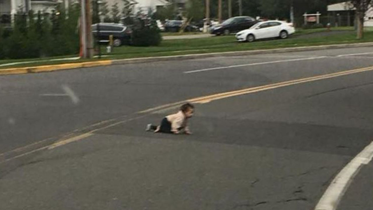Father Arrested After Photo Of Baby Crawling In Street