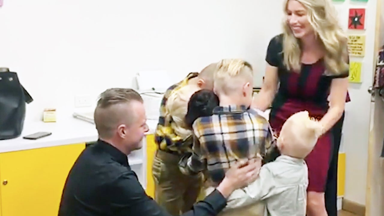 11-year-old Sebastian hugs his new family.