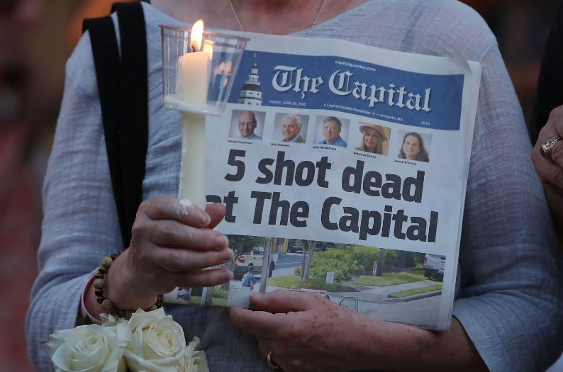 A gunman walked into a newspaper office and killed five people.