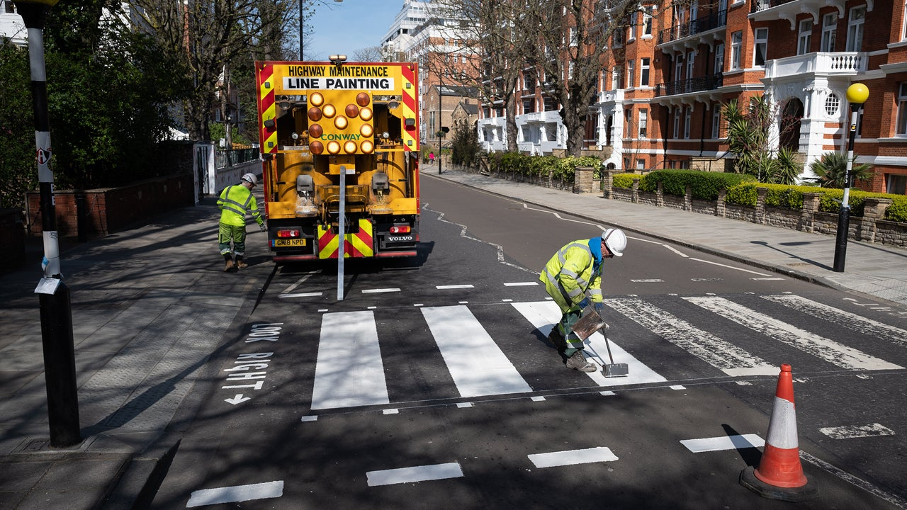 The Beatles' Abbey Road Crosswalk Repainted During ...