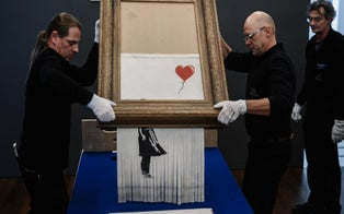 Banksy's Famous 'Love is in the Bin' Shredded Painting Sells for an Astounding $25.4 Million at Auction