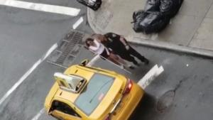 New York City Cop Helps a Visually Impaired Woman Catch a Cab