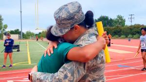 Teen Surprised by Military Mom at Race Finish Line: 'I Instantly Started Crying'
