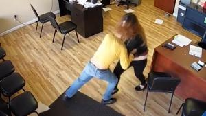 Woman Fights Back After Man With Knife Attacks at Family Car Insurance Business