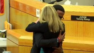 Why This Hug With Amber Guyger Is Being Commended and Criticized
