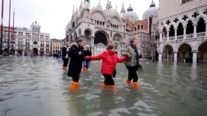 Woman's Luggage Floats Through Flooded Streets of Venice