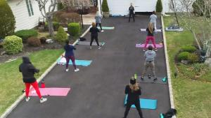 Fitness Coach Teaches Classes From Her Driveway During Coronavirus Pandemic