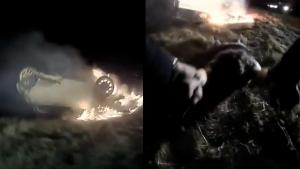 Cop Drags Woman From Burning Car After it Flipped and Crashed in Field