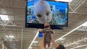 5-Month-Old Girl Can't Get Enough of the Camera at Walmart