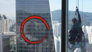 How a Parapalegic Climber Scaled a Hong Kong Skyscraper