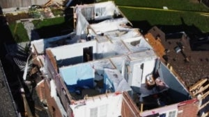 Woman Horrified to Discover Tornado Ripped the Roof Off Her Home