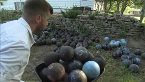 Man Finds 160 Bowling Balls Mysteriously Buried in His Backyard