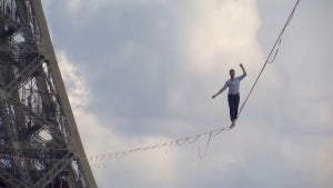 Daredevil Nathan Paulin Walks Tightrope From Eiffel Tower to Chaillot Theater