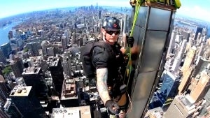 This Man Bravely Dangles From Skyscrapers as Part of His Job