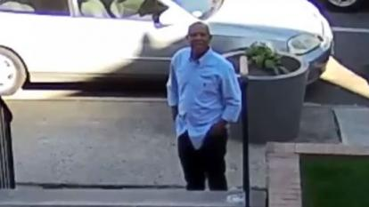 Police released surveillance footage of a man they say is stalking a young boy and girl.