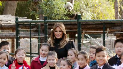 A giant panda posed for a photo with Melania Trump.