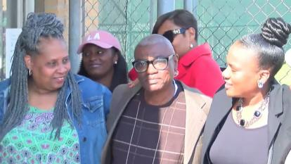 Wilbert Jones surrounded by family members as he was released from prison.