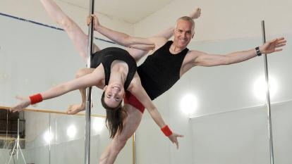 Dave Roberts, 52, and his eldest daughter Hazel, 27, perform moves on the pole.