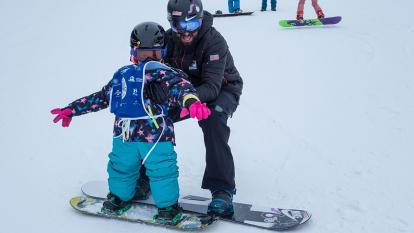 Lilly Biagini, 10, learns to ski for the first time, thanks to Paralympic bronze medalist Keith Gabel.