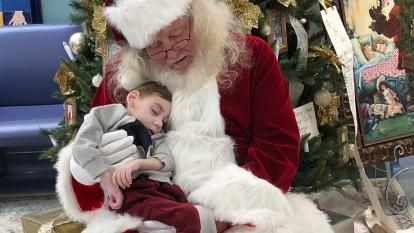 Santa holds Miles Agnew, 2, days before he died.