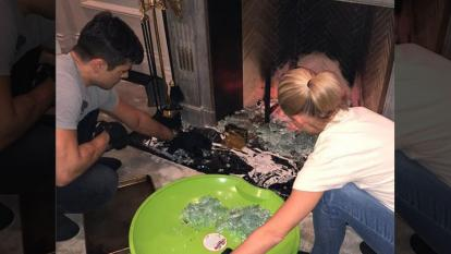 Mark Consuelos and Kelly Ripa resorted to using sleds and cookie sheets to scoop up broken glass.