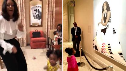 Michelle Obama danced with the little girl who was wowed by Obama's new portrait.