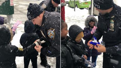Detective Kaz Daughtry, Officer John Dorrejo and Officer Richard Russo outfitted a group of kids with brand new gloves.