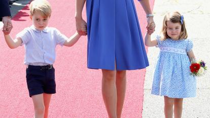 Prince George and Princess Charlotte walk hand in hand with their mom, Duchess Kate Middleton.