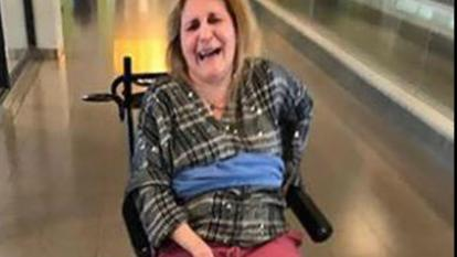 Maria Saliagos, who has MS, says she was tied to a wheelchair by Delta Airlines employees.