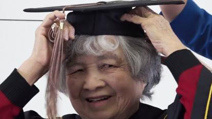 Phuong Truong, 75, tries on her graduation cap ahead of the big day.