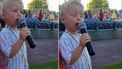 Drake Grillo, 3, belts out the Star Spangled Banner.