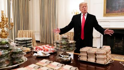 Trump standing in front of fast food