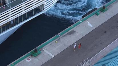Video captured the pair looking dejected at the ship leaves them behind.