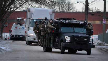 Police secure the area following a shooting at the Henry Pratt Company on Feb. 15, 2019, in Aurora, Illinois. Five people were reported dead and 5 police officers wounded from the shooting.