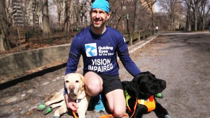 Thomas Panek, 49, became the first blind marathoner to complete the NYC half with the help of guide dogs.