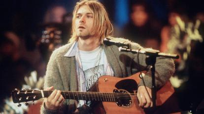 "Kurt Cobain performing with Nirvana during a taping MTV ""Unplugged"" in 1993."