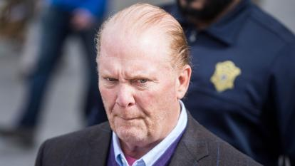 Mario Batali arrives to Boston court to plead guilty to a charge of indecent assault and battery.