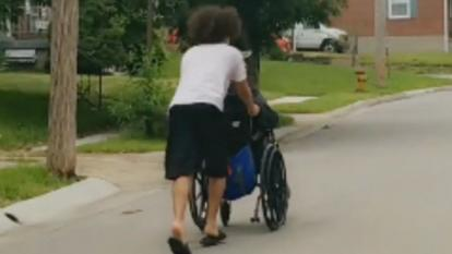Seth Phillips took a hold of Gregory Beck's wheelchair and pushed him all the way home.