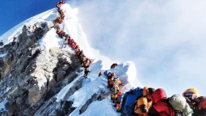 Long lines form as climbers are eager to reach the summit of Mount Everest.