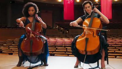 "Lizzie and Charlotte play the cello side-by-side in a scene from Netflix's new ""The Perfection."""